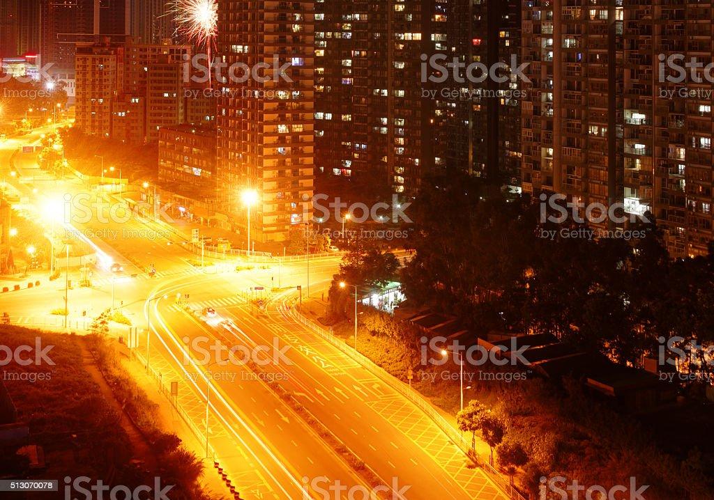 Street scene of urban city street at night stock photo