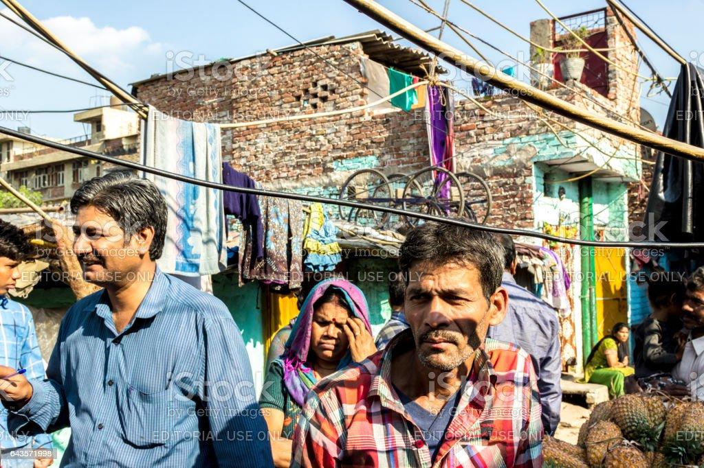 street scene with people in the poor area of  Delhi stock photo