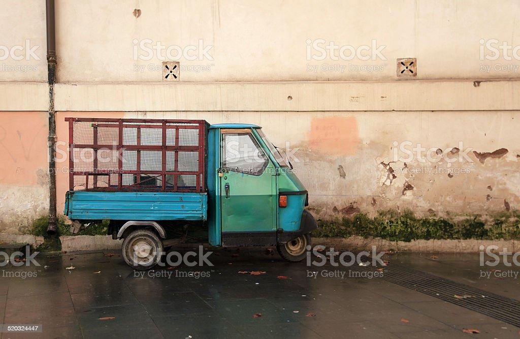 Street scene with small 3 wheeled truck. Rome Italy. stock photo