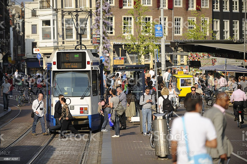 Street scene with tram and crowd of people in Amsterdam royalty-free stock photo