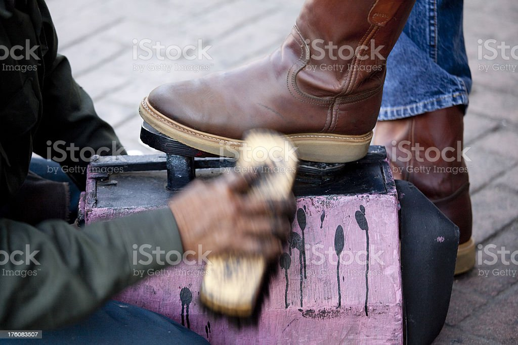 Street Shoeshine Person Shining Leather Boots, Motion Blur royalty-free stock photo