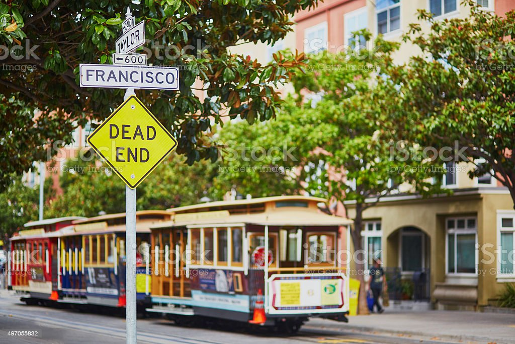 Street sign and cable cars in San Francisco stock photo