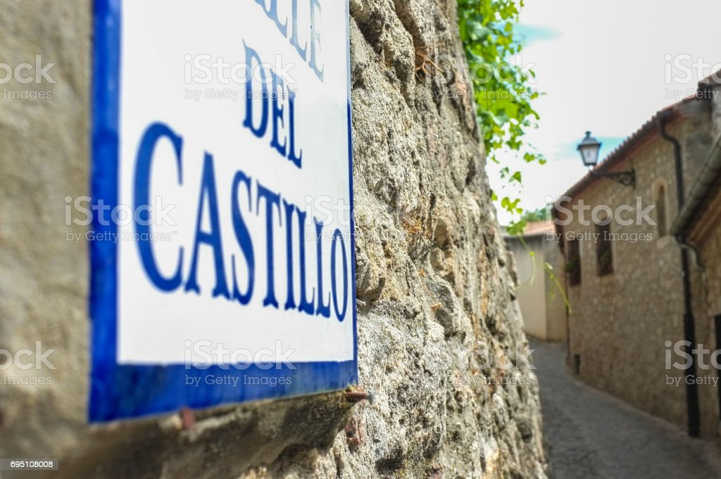 Street sign at stone  houses of Trujillo street, Extremadura, Spain. Old town stock photo
