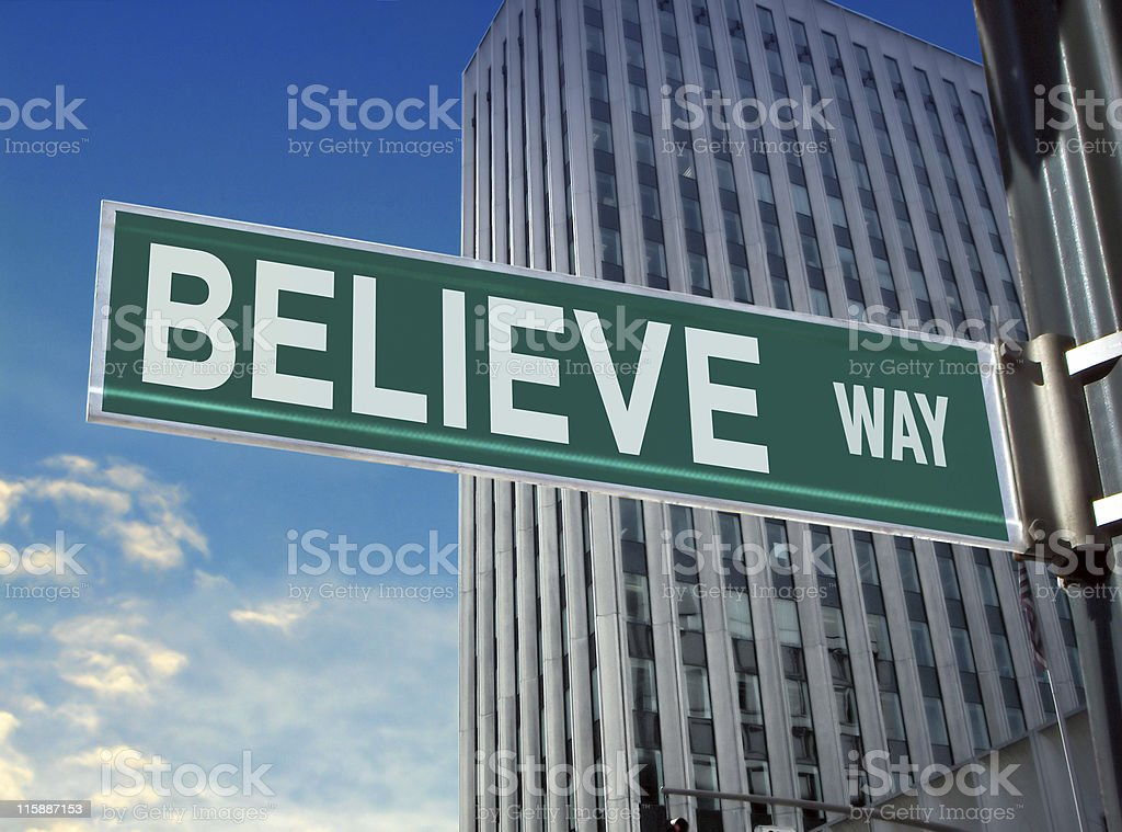 Street Sign: Believe stock photo