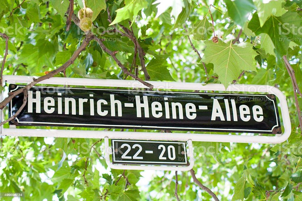 Street sign Heinrich Heine Allee in Dusseldorf Germany stock photo