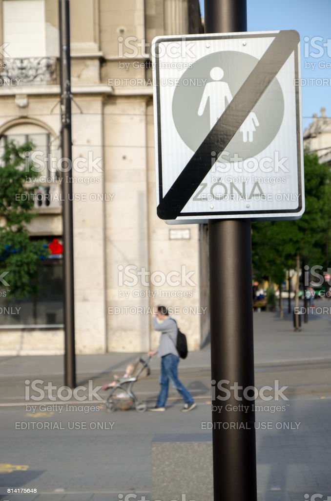 Street sign showing that it is forbidden to walk with a child in the area stock photo