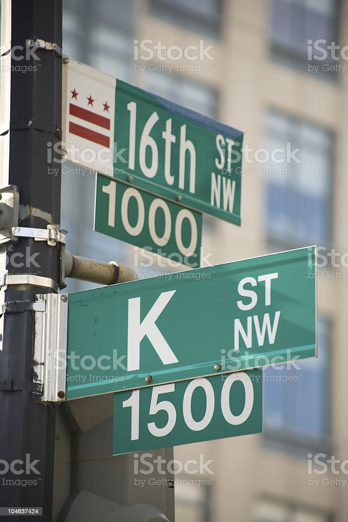 K street sign with building in the background stock photo