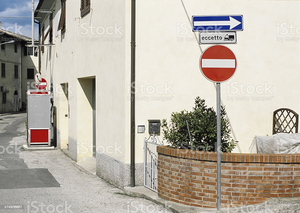 Street signs and old telephone box royalty-free stock photo