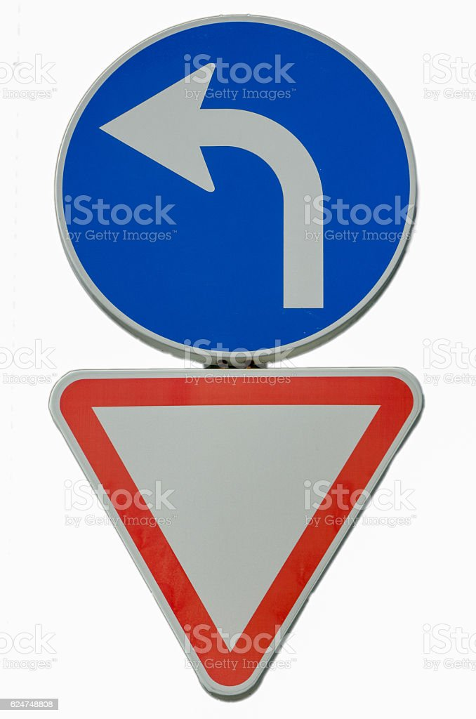 Street signs stating vehicles must turn left and yield stock photo