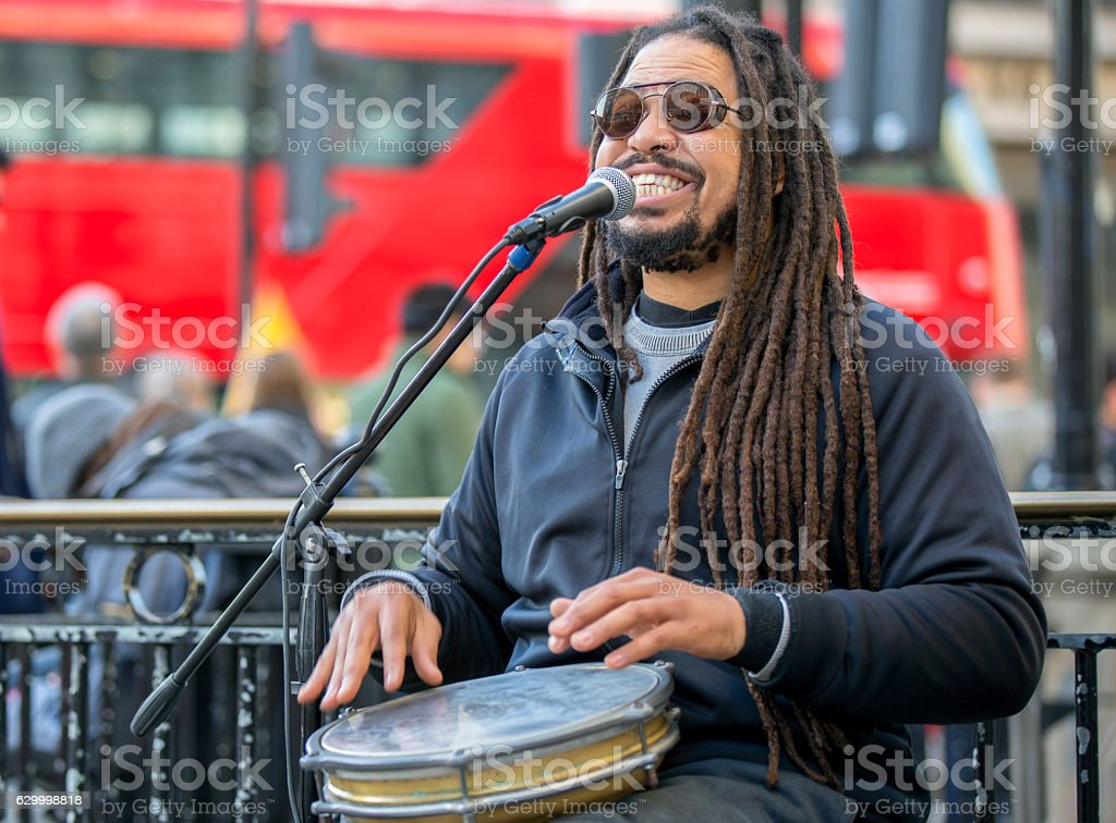 Street singer with jembe. United Kingdom stock photo