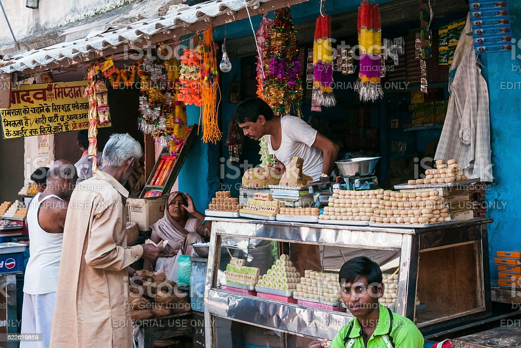 Street stall with a good assortment of sweets for sale stock photo