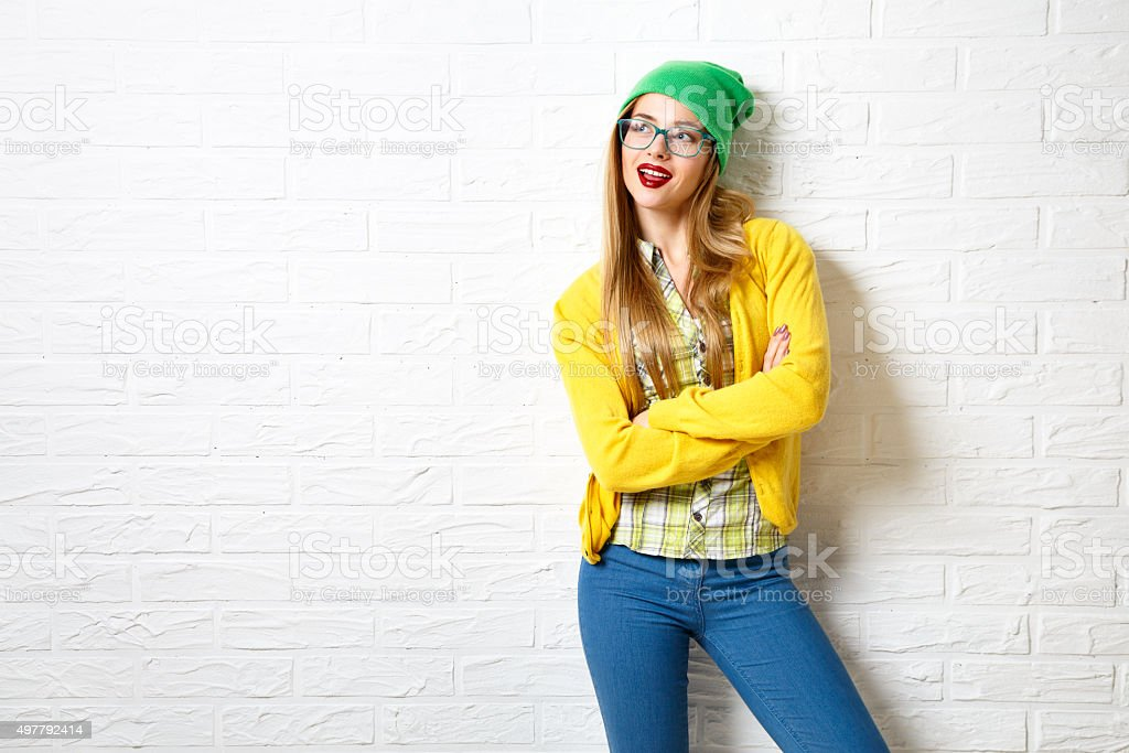 Street Style Hipster Girl at White Brick Wall Background stock photo