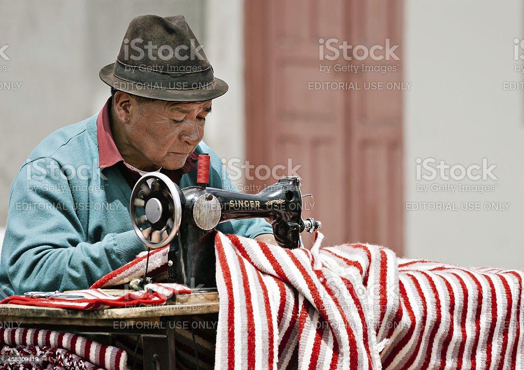 Street tailor at Saquisili market, Ecuador stock photo