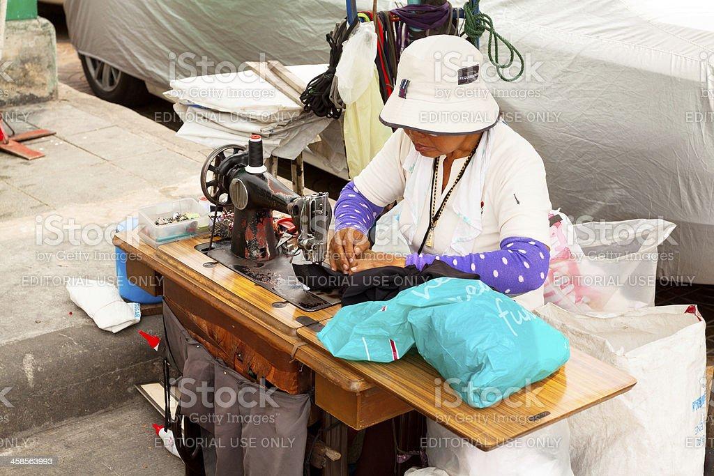 Street tailoress in Bangkok stock photo
