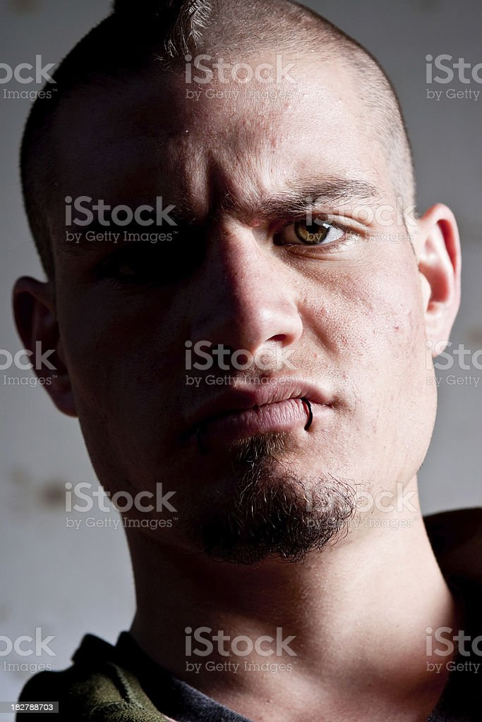 Street thug with attitude and dark shadows royalty-free stock photo
