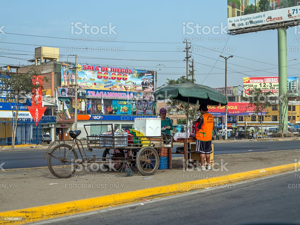 Street trader selling food from her mobile stall stock photo