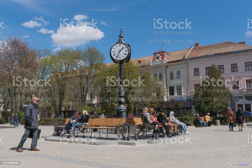 Street tripartite clock with large backlight. Ternopil. Ukraine. stock photo
