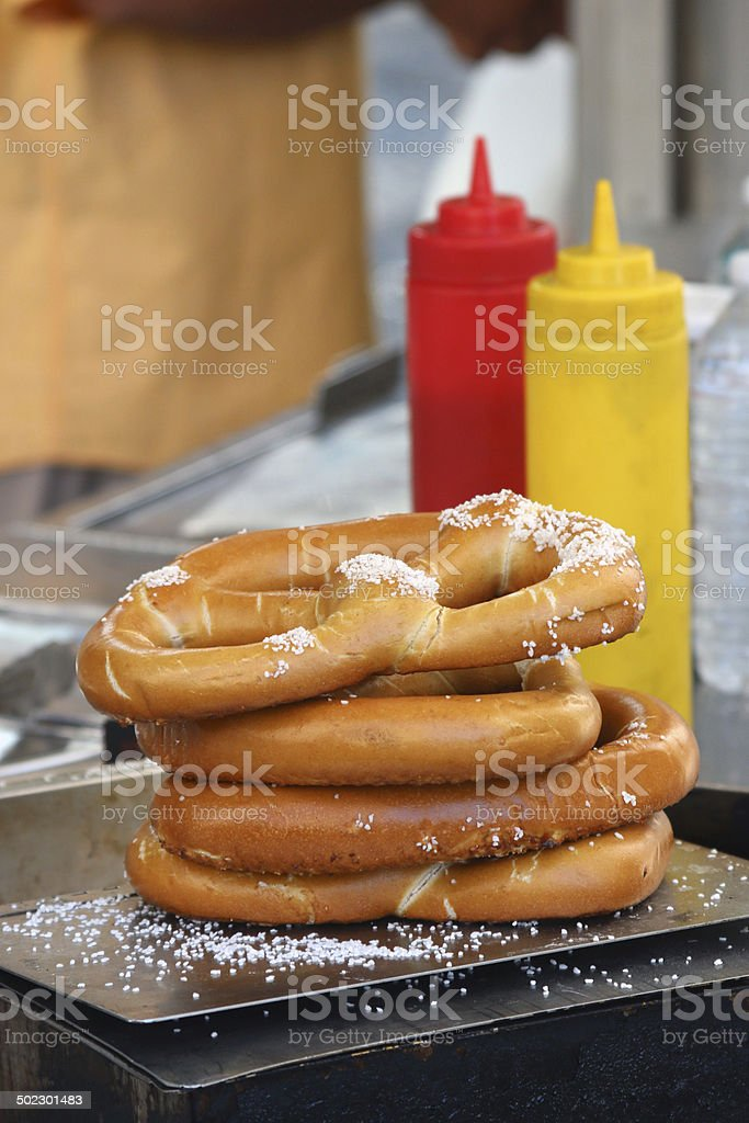 Street vending with pretzels, ketchup and mustard stock photo