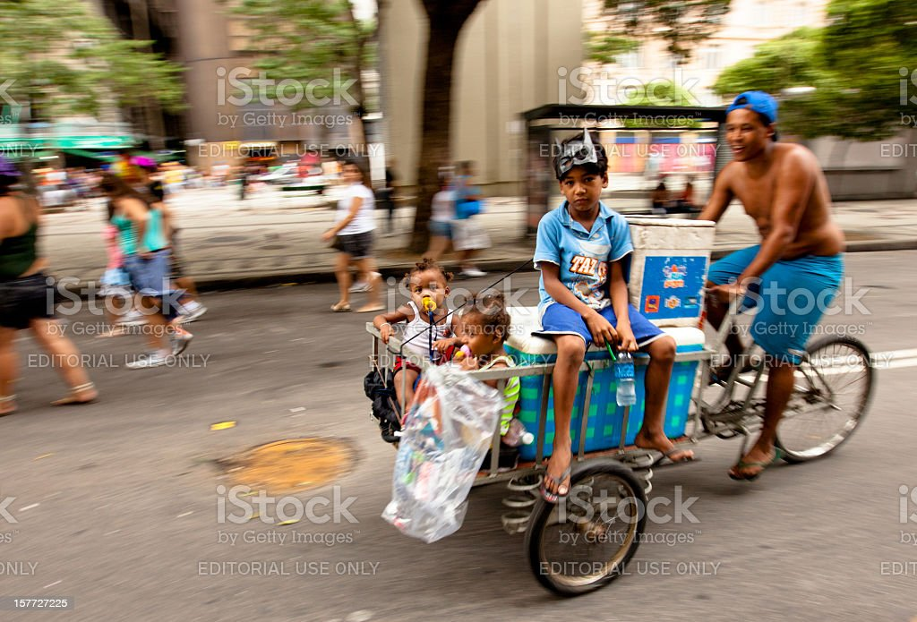 Street vendor on bicycle with his children royalty-free stock photo