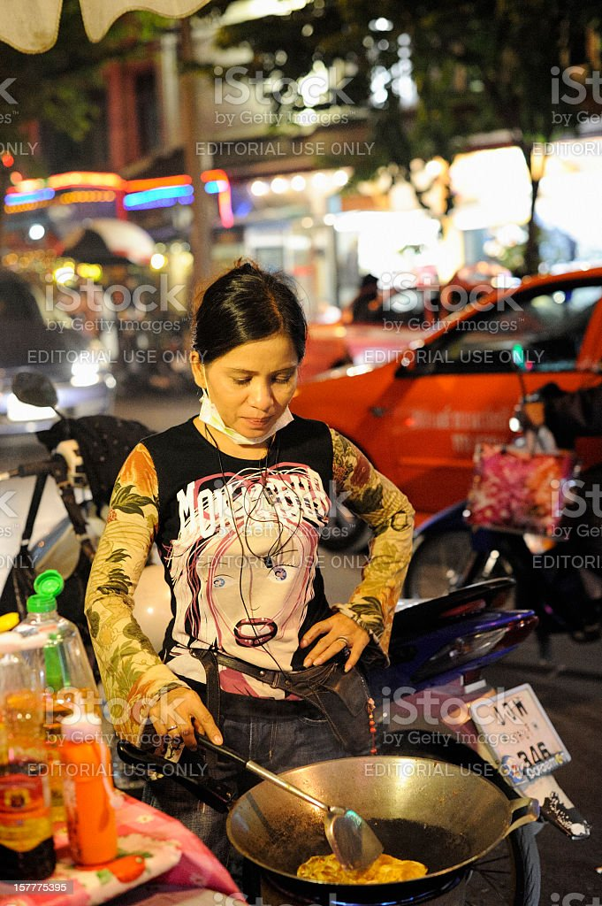 Street Vendor Preparing Food in Mobile Kitchen on Sukhumvit Road royalty-free stock photo