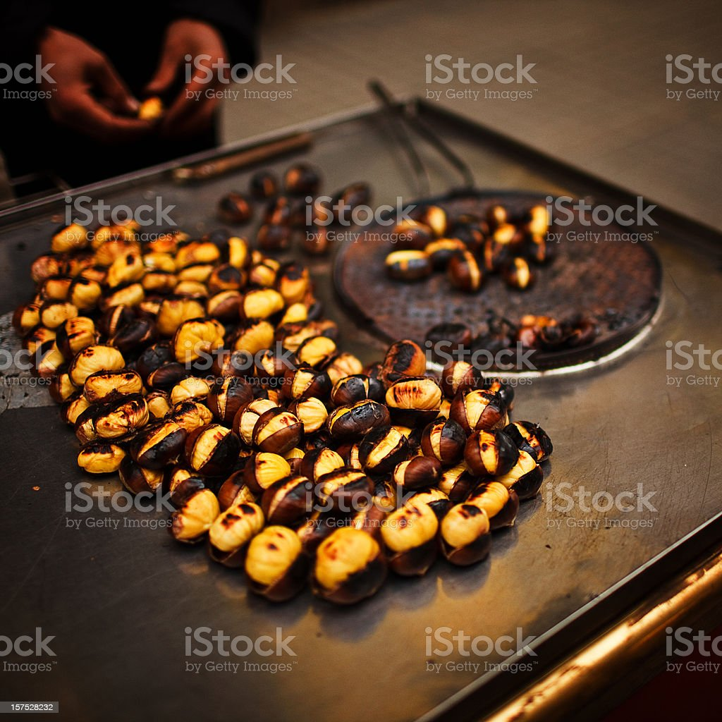 Street vendor roasting chestnuts royalty-free stock photo