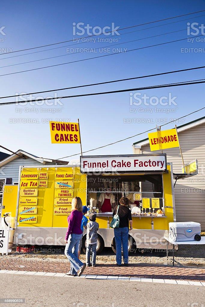 Street Vendor Selling Funnel Cakes stock photo