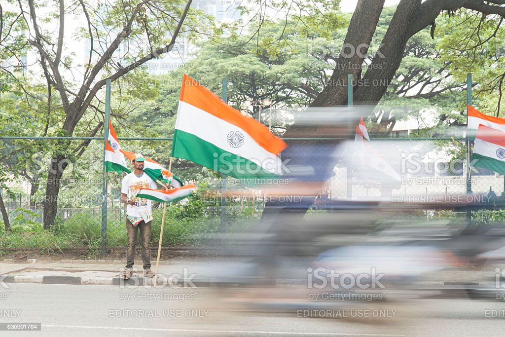 Street vendor selling Indian flags before independence day. stock photo