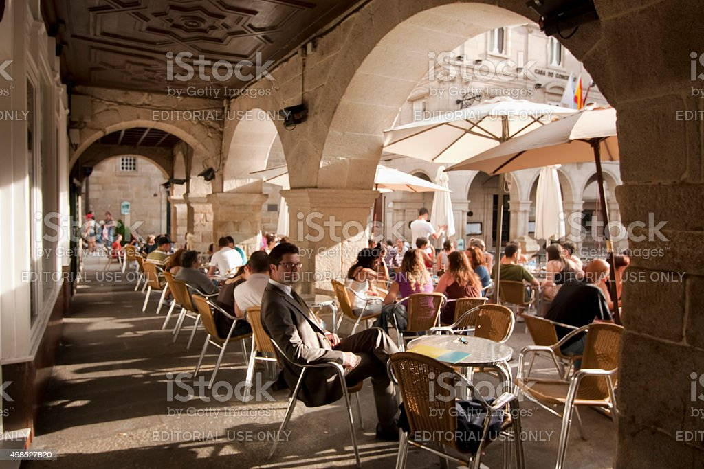 Street view in Ourense, stone arches with sidewalk cafes. stock photo