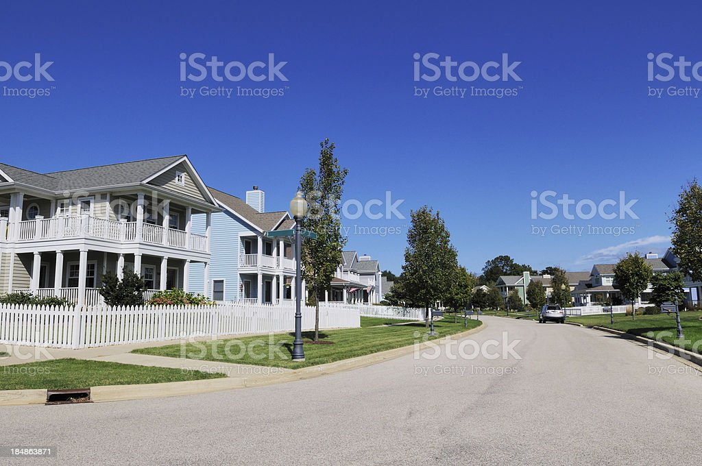 Street View of Modern Michigan Houses with White Picket Fence royalty-free stock photo