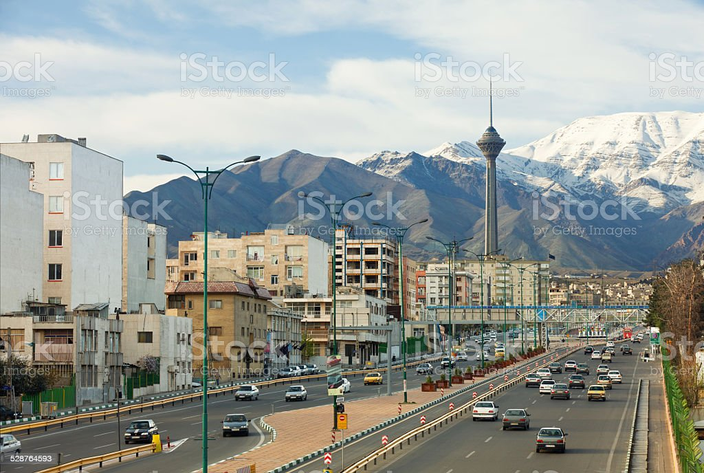 Street View of Tehran with Milad Tower and Alborz Mountains stock photo