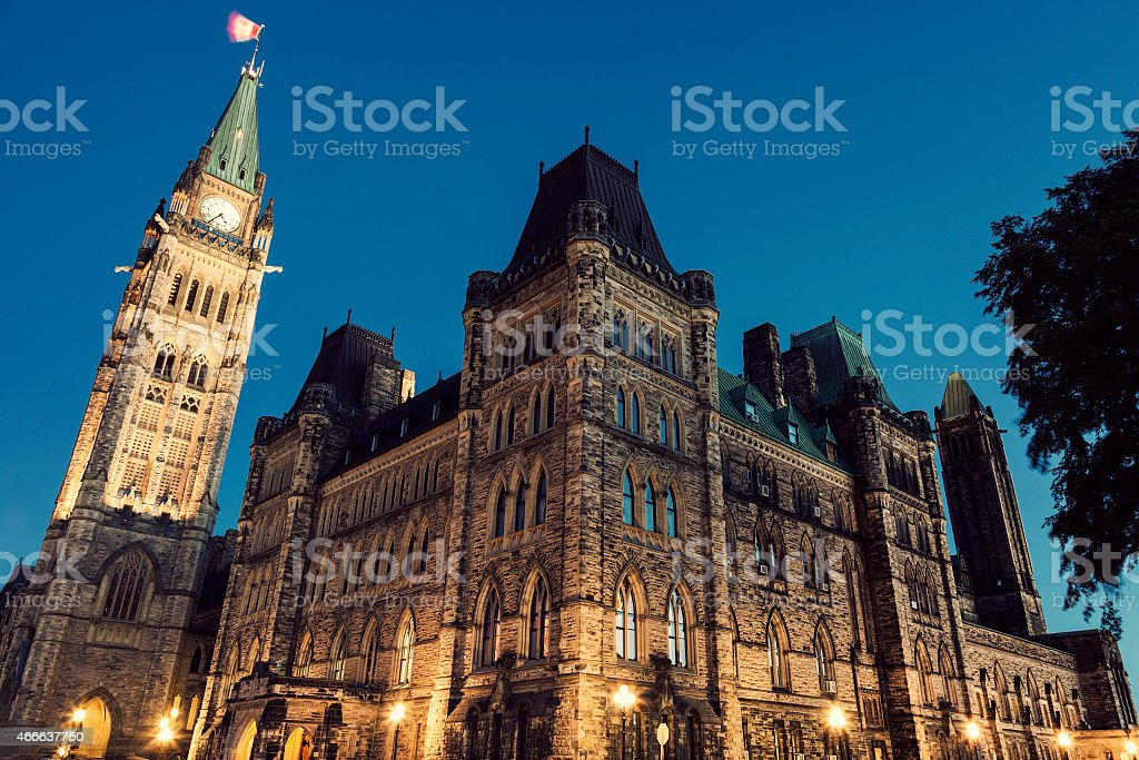 Street view of the Canadian parliament building at night stock photo
