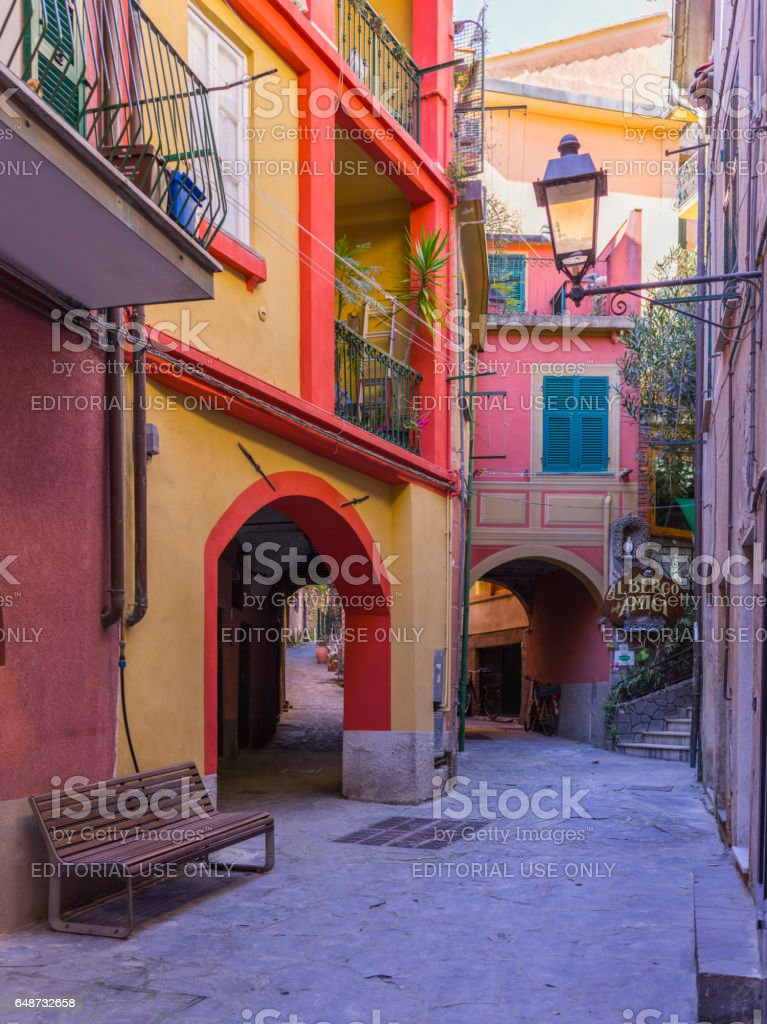 Street view with colored facades, sign of a restaurant, and lamppost stock photo