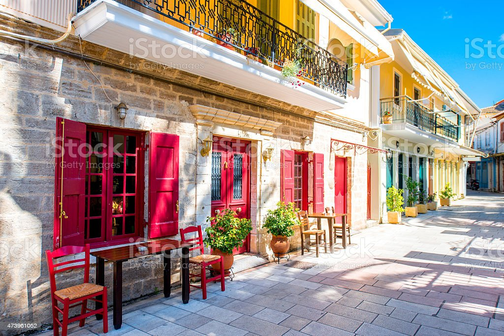 Street view with colorful old houses in Greece stock photo
