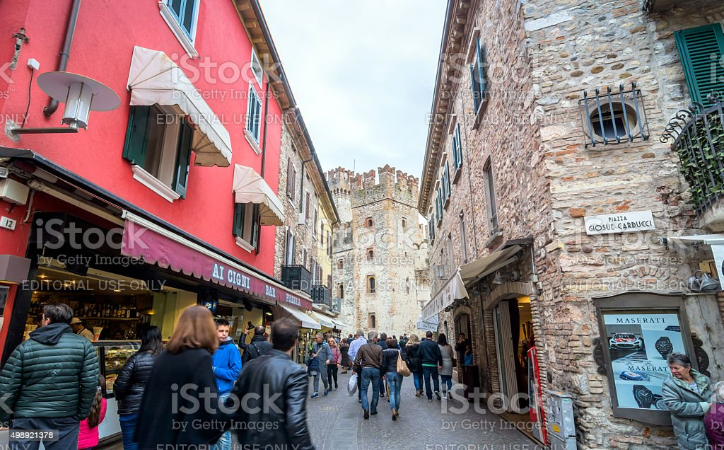 street view with shops and tourists in Sirmione stock photo