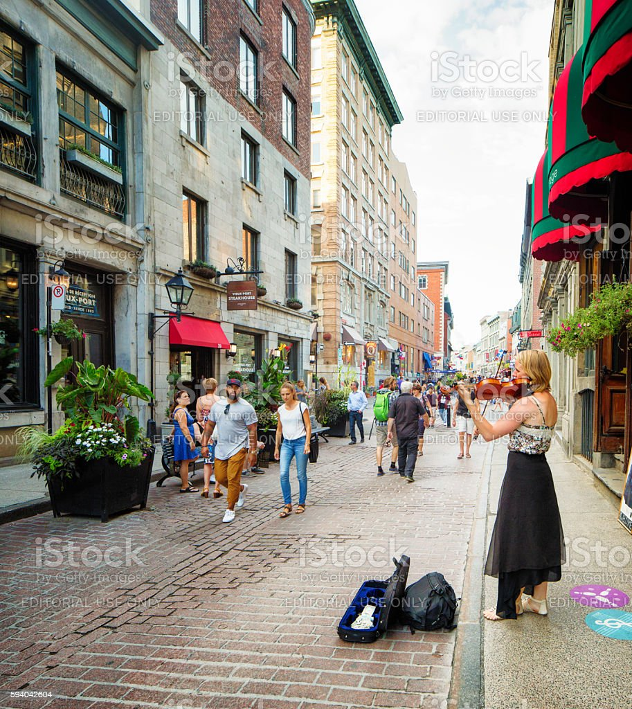 Street violonist plays for donations in old Montreal stock photo