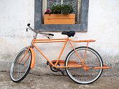 Street, wall and orange bike