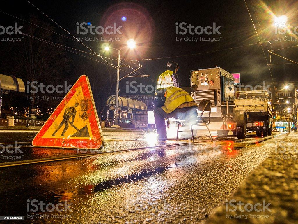 Street welder during work stock photo