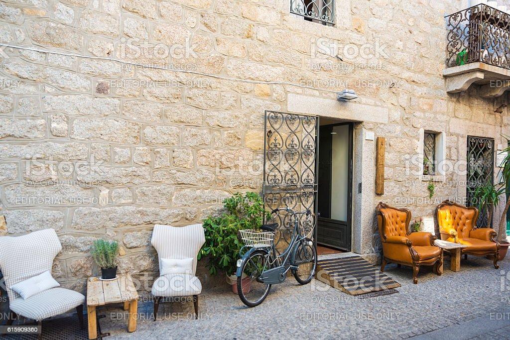 Street with bar terraces in Olbia, Sardinia, Italy stock photo