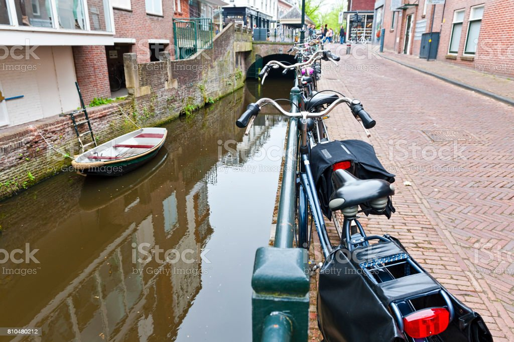 Street with Bikes Parked on an Embankment stock photo