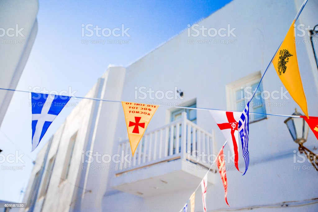 Street with colorful flags in Mykonos, Greece stock photo