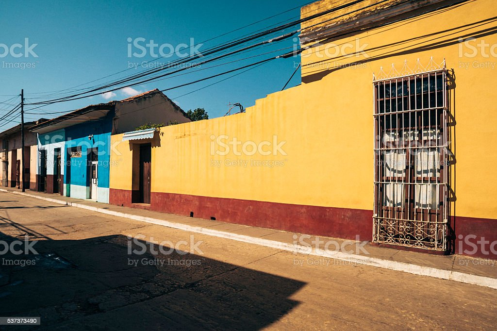 Street with coloured houses in Trinidad, Cuba stock photo