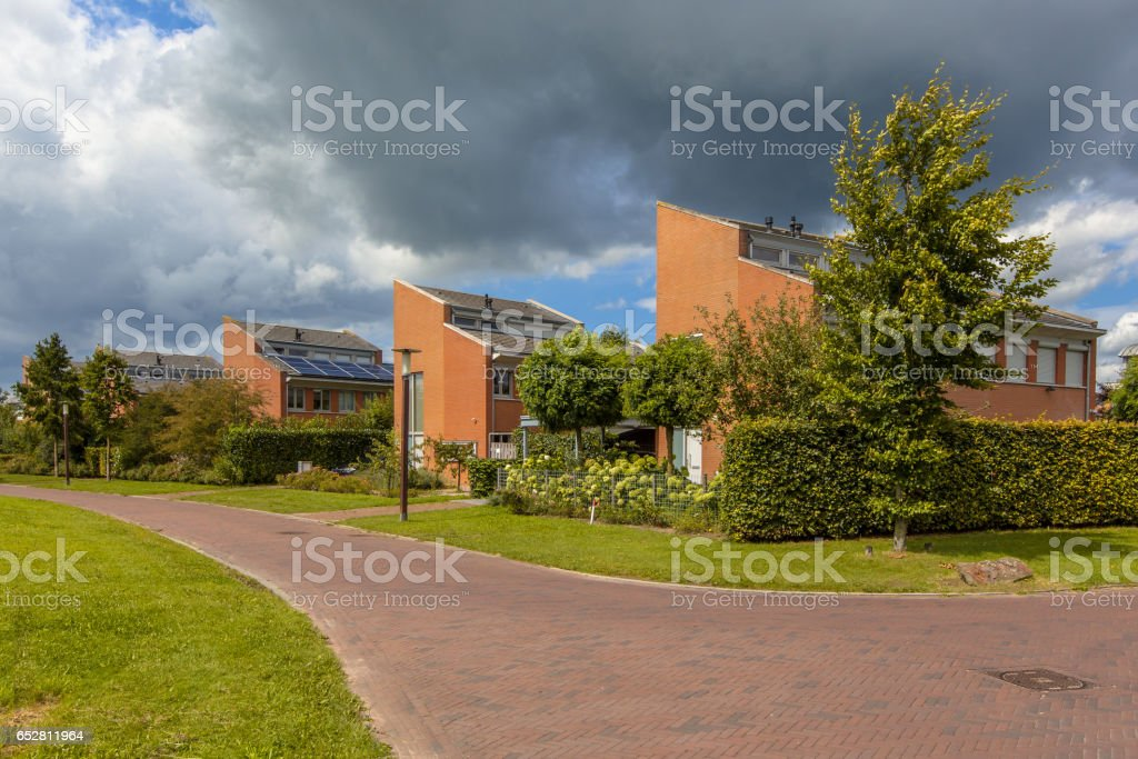 Street with detached houses stock photo
