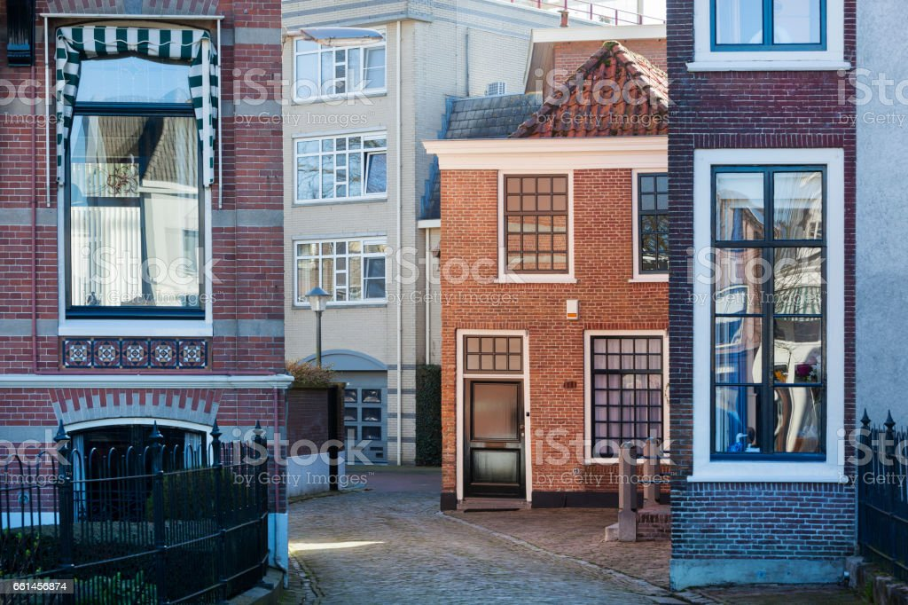 Street with different houses in Gorinchem stock photo