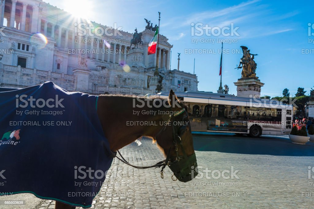 Street with horse carriages in Rome, Italy. stock photo