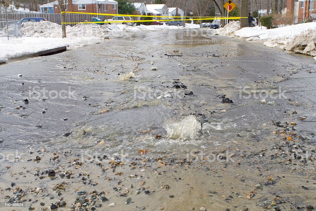 Street with Number of Small Fountains from Broken Water Main royalty-free stock photo