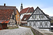 Street  with old half-timbered houses and the church.