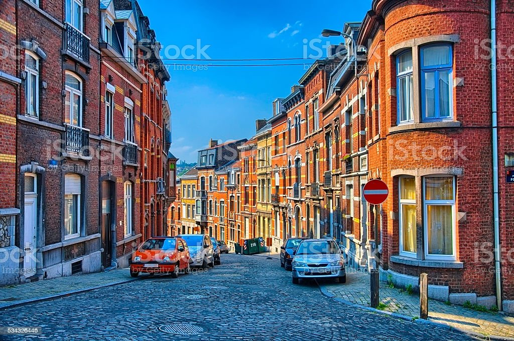 Street with red brick houses in Liege, Belgium, Benelux, HDR stock photo