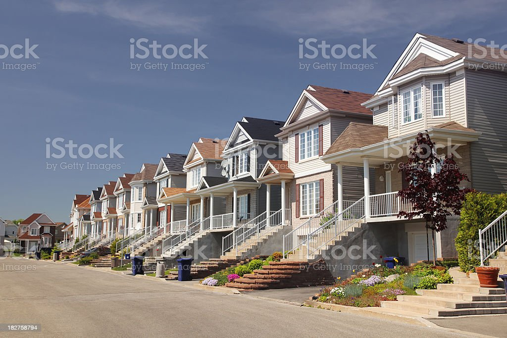 Street with similar homes stock photo