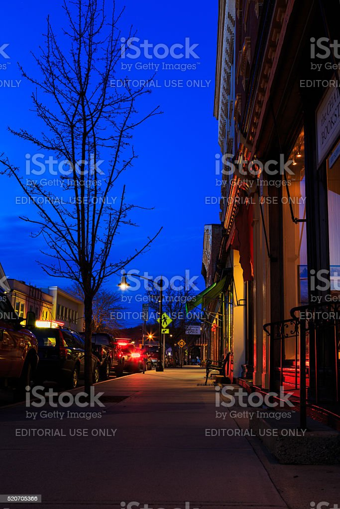 Street with store front early evening Chatham NY stock photo