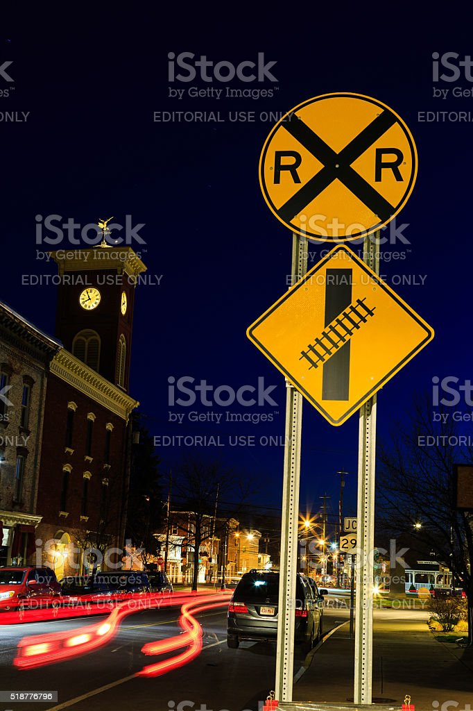 Street with streaming cars and clock tower Chatham NY stock photo